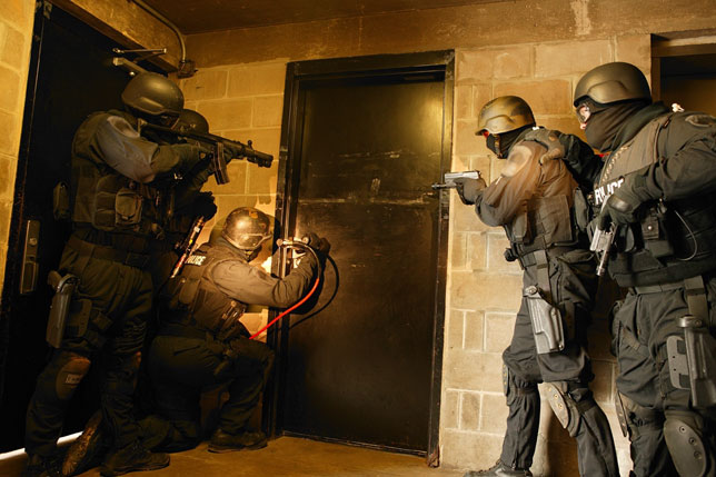2047SWAT-Team-about-to-blow-door_PG.jpg.8e378ae8603607ecacf8efe6784188d2